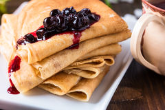 Crepes  folded in triangles with currant jam Royalty Free Stock Photography
