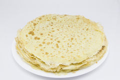 Crepes - French dessert. Fried crepes (pancakes) in white plate on white background Stock Image