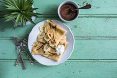Crepes or French Pancake with Chocolate and Banana. Crepes or French Pancake on Blue Background royalty free stock photos