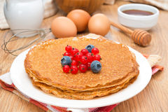 Crepes with fresh berries and ingredients for baking, horizontal Royalty Free Stock Photo