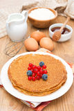 Crepes with fresh berries and ingredients for baking Stock Photos