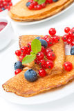 Crepes with fresh berries and jam for breakfast, close-up Royalty Free Stock Images