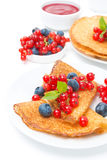 Crepes with fresh berries and jam for breakfast, isolated Stock Photo