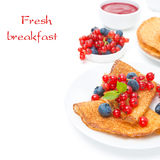 Crepes with fresh berries and jam for breakfast, isolated Stock Photography