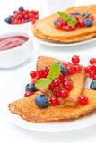 Crepes with fresh berries and jam for breakfast Stock Images