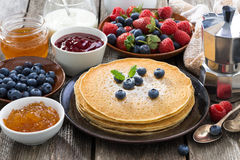 Crepes, fresh berries and jams Royalty Free Stock Image