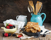 Crepes with fresh raspberry and blackberry Stock Image