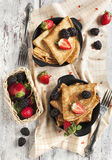 Crepes with fresh raspberry and blackberry. Served in small frying pan Royalty Free Stock Images