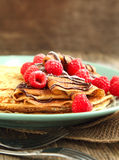 Crepes with fresh raspberry and powder sugar. On plate Royalty Free Stock Images