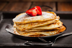 Crepes with fresh strawberries Stock Photos