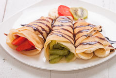 Crepes. With fruits (strawberry ,   kiwi Royalty Free Stock Images