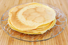 Crepes on glass plate Royalty Free Stock Photography