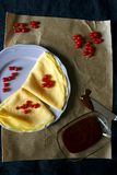 Crepes. Homemade crepes with chocolate spread and red currants. Top view royalty free stock photos