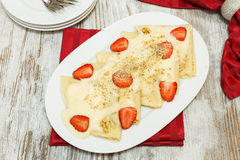 Crepes with honey, strawberries  and walnuts Stock Photo