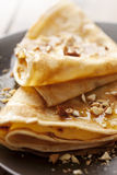 Crepes with honey or syrup and roasted nuts Royalty Free Stock Images