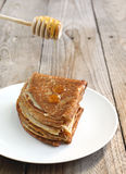 Crepes with honey Royalty Free Stock Photos
