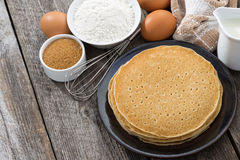 Crepes and ingredients for their preparation, top view Royalty Free Stock Photo