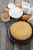 Crepes and ingredients for their preparation, vertical, top view Royalty Free Stock Photos