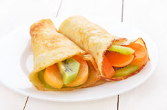 Crepes with kiwi and apricot slices Stock Image