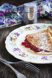 Crepes with lingonberry jam Stock Image