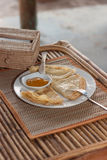 Crepes with mango jam on mat Stock Image