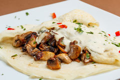 Crepes with mushrooms Stock Photography