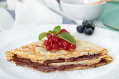 Crepes with  nutella. In the pot on the table Royalty Free Stock Photo