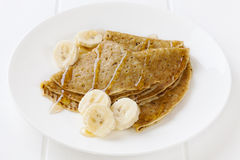 Crepes or Pancakes with Banana and Maple Syrup royalty free stock photography