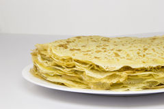Crepes (pancakes). Stack of crepes (pancakes) on white plate closeup Royalty Free Stock Image