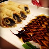 Crepes with poppy filling and chocolate-caramel sauce. Beautiful royalty free stock images
