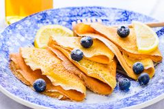 Crepes with powdered sugar and berries breakfast plate. Stock Image