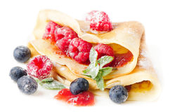 Crepes with raspberries and blueberries. On white Stock Image