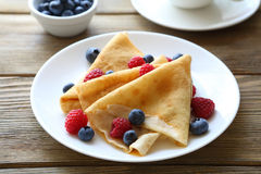 Crepes with raspberries, blueberries, Stock Images