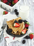 Crepes with raspberry and blackberry. Crepes with fresh raspberry and blackberry Royalty Free Stock Image
