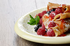 Crepes raspberry blueberries mint Royalty Free Stock Photo