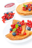 Crepes with red currants, blueberries and jam for breakfast Stock Photos
