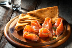 Crepes with salmon. View of nice fresh hot crepes with smoked salmon on color background stock image