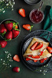 Crepes served with cream cheese and fresh strawberry Royalty Free Stock Photos