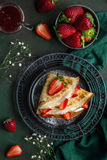 Crepes served with cream cheese and fresh strawberry, Royalty Free Stock Image