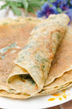 Crepes with spinach closeup vertical Stock Images