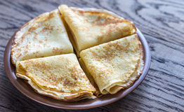 Crepes. Stack of crepes on the plate on the wooden background Royalty Free Stock Image