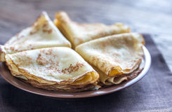 Crepes. Stack of crepes on the plate on the wooden background Stock Photography