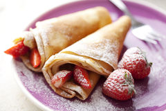 Crepes with strawberries royalty free stock photography