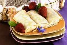 Crepes With Strawberries. Crepes On Golden Plate With Mint, Strawberries And Edible Borage Flowers Royalty Free Stock Photo