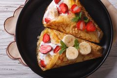 Crepes with strawberries and bananas  closeup horizontal top vie Royalty Free Stock Photo