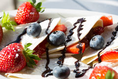 Crepes with strawberries and blueberries Royalty Free Stock Photography