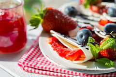 Crepes with strawberries and blueberries Royalty Free Stock Images