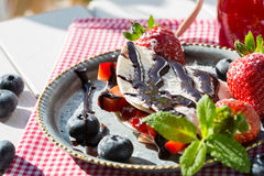Crepes with strawberries and blueberries Stock Image