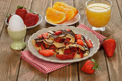 Crepes with strawberries and chocolate Royalty Free Stock Photos