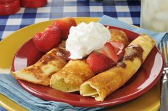 Crepes with strawberries and chocolate sauce Stock Images